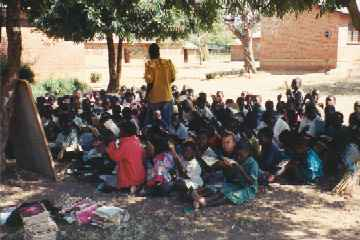 Class under the trees at St. Denis Primary School